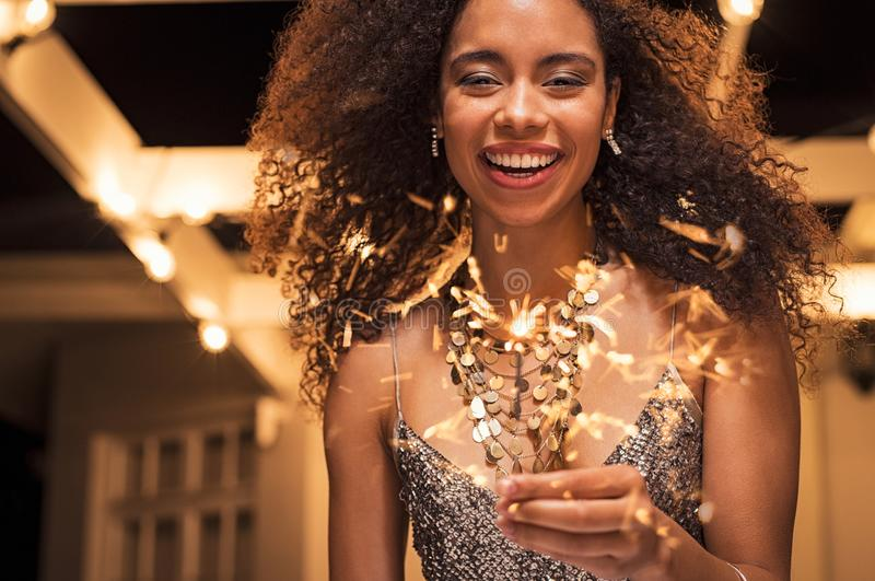 Smiling woman with bengal light royalty free stock image