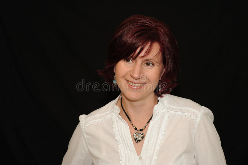 Download Smiling woman on black stock image. Image of portrait - 5486627