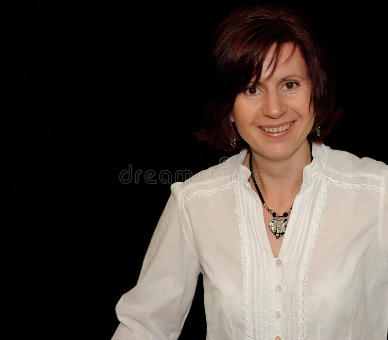 Download Smiling woman on black stock image. Image of grin, blouse - 5486839