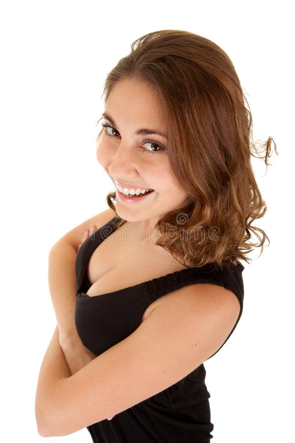 Smiling woman in a black dress stock photos