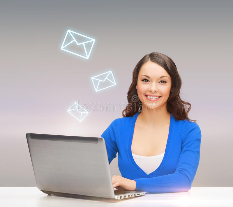Download Smiling Woman In Blue Clothes With Laptop Computer Stock Photo - Image: 40042520