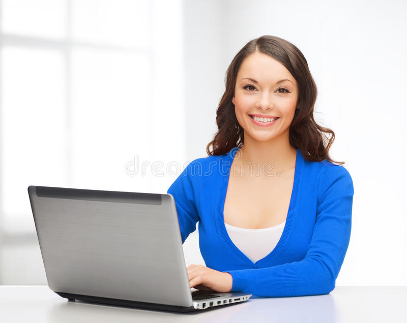 Smiling Woman In Blue Clothes With Laptop Computer Stock Photo