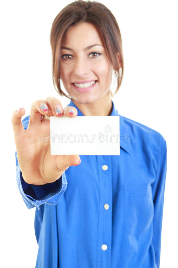 Smiling woman in blue shirt holds out a business or credit card. Beautiful smiling woman in blue shirt holds out a business or credit card Isolated on white stock photo