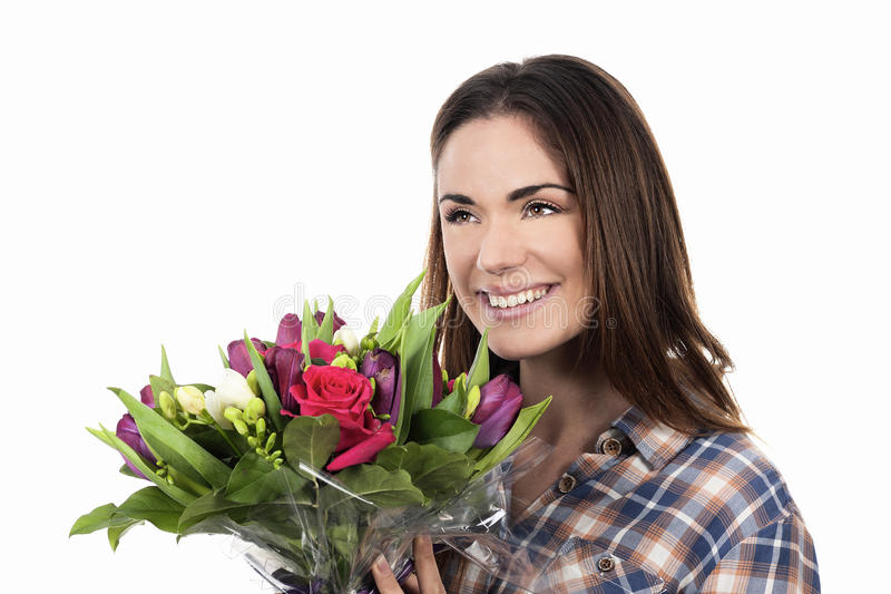 Smiling woman with bouquet. Happy smiling woman with bouquet stock photo