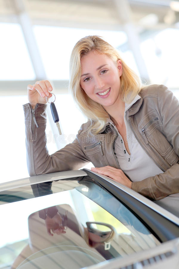 Smiling woman buying new car stock photos