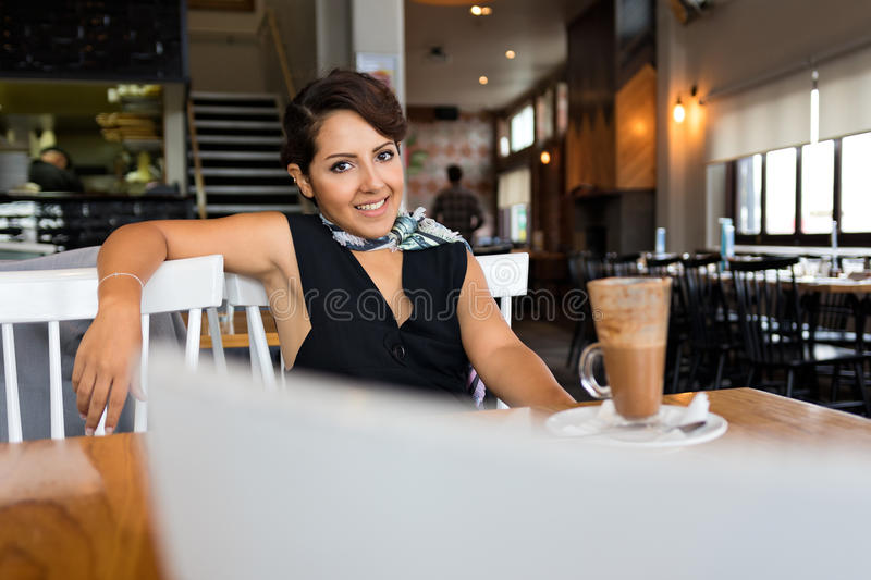 Smiling Woman in Cafe royalty free stock photo