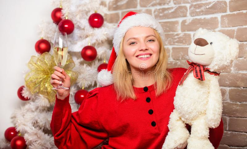 Smiling woman celebrating christmas. Merry christmas and happy new year. New year party. happy girl in santa claus hat royalty free stock image