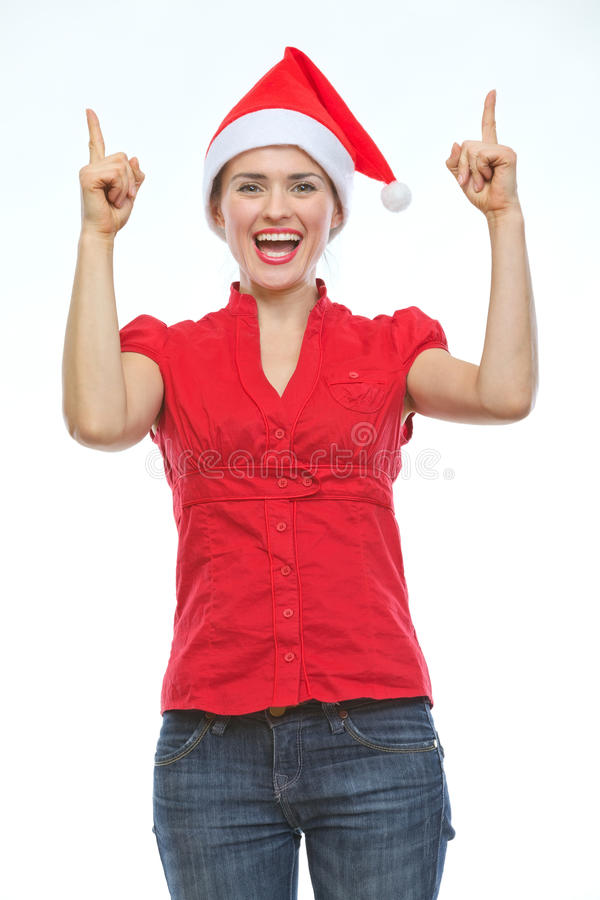 Download Smiling Woman In Christmas Hat Pointing Up Stock Photo - Image: 26104768