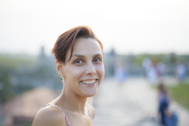 Smiling woman close up. royalty free stock photography