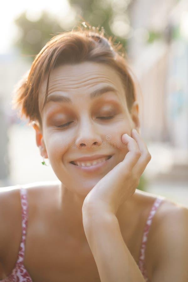 Smiling woman close up. stock photos