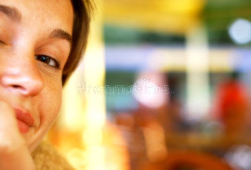 Smiling woman at the coffee shop stock photography
