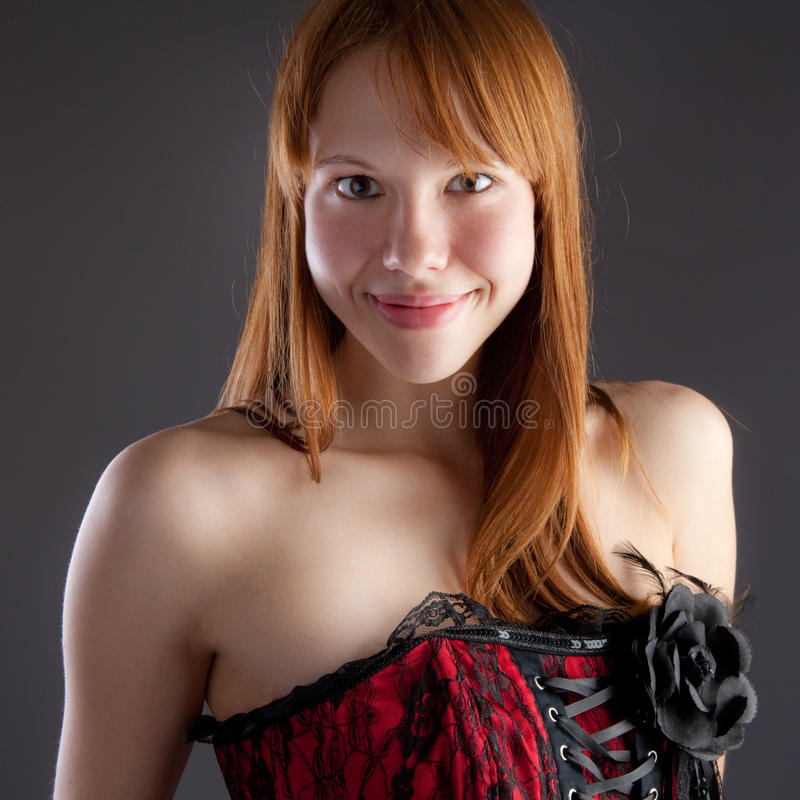 Smiling Woman in Corset stock photos