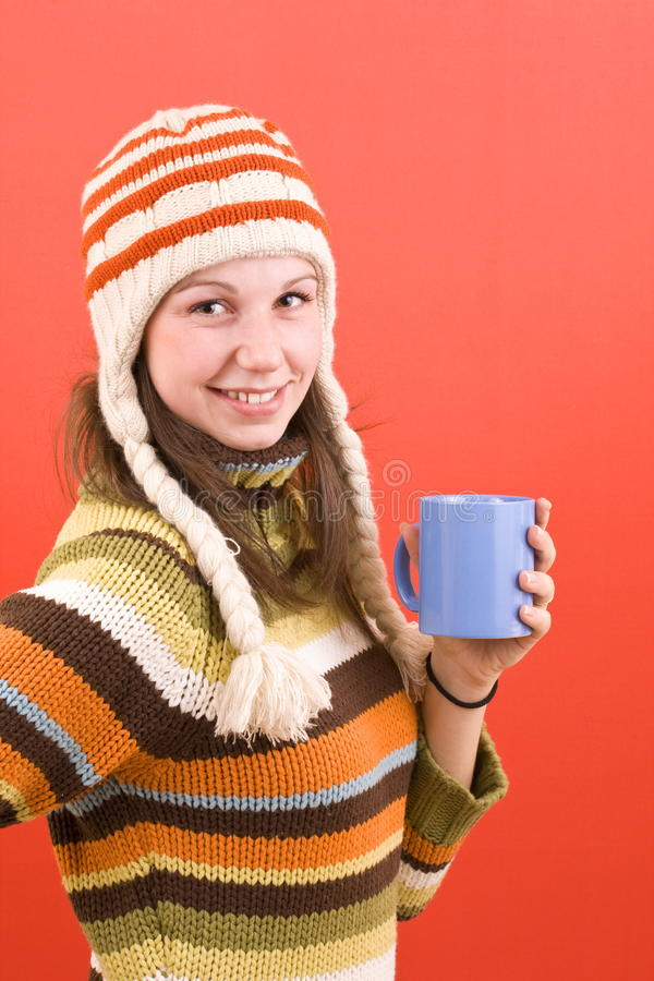 Smiling woman with cup royalty free stock photography