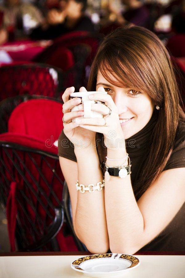 Smiling woman with a cup of coffee stock image