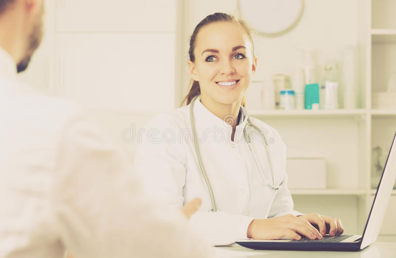 Smiling woman doctor consultation stock images