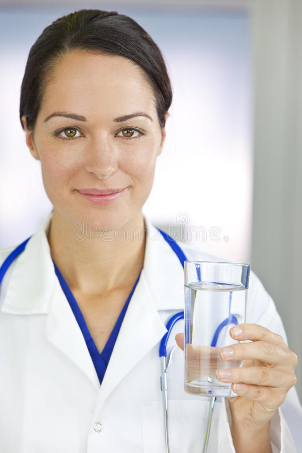 Smiling Woman Doctor Holding Glass of Water stock image