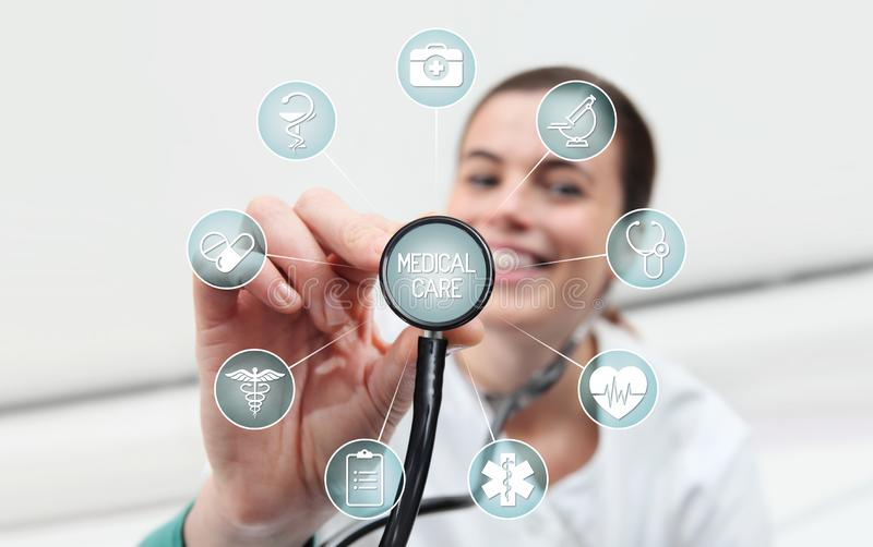 Smiling woman doctor with stethoscope touch medical symbols icons, diagnosis and treatment concept royalty free stock image