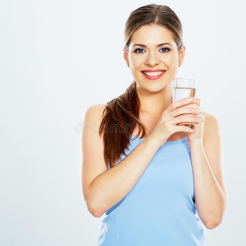 Smiling woman drink water with glass . white background royalty free stock photo