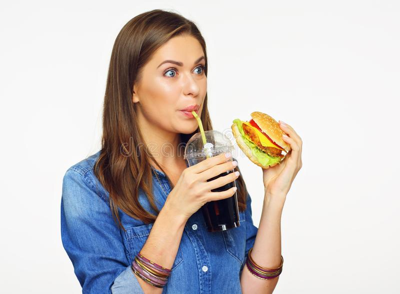 Smiling woman drinking cola drink. Unhealthy fast food meal. royalty free stock photo