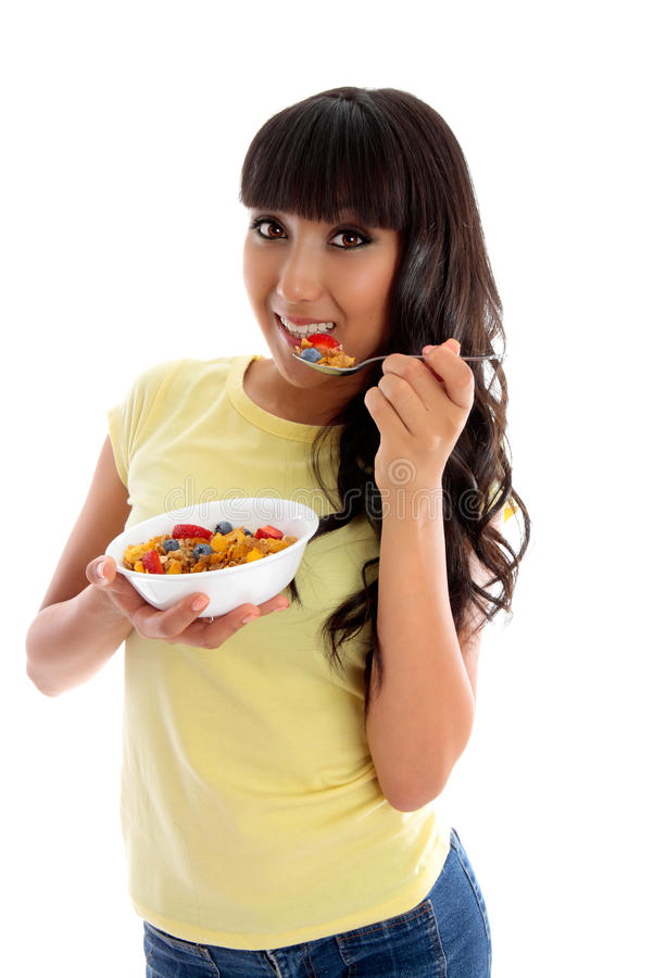Smiling woman eating cereal breakfast royalty free stock image