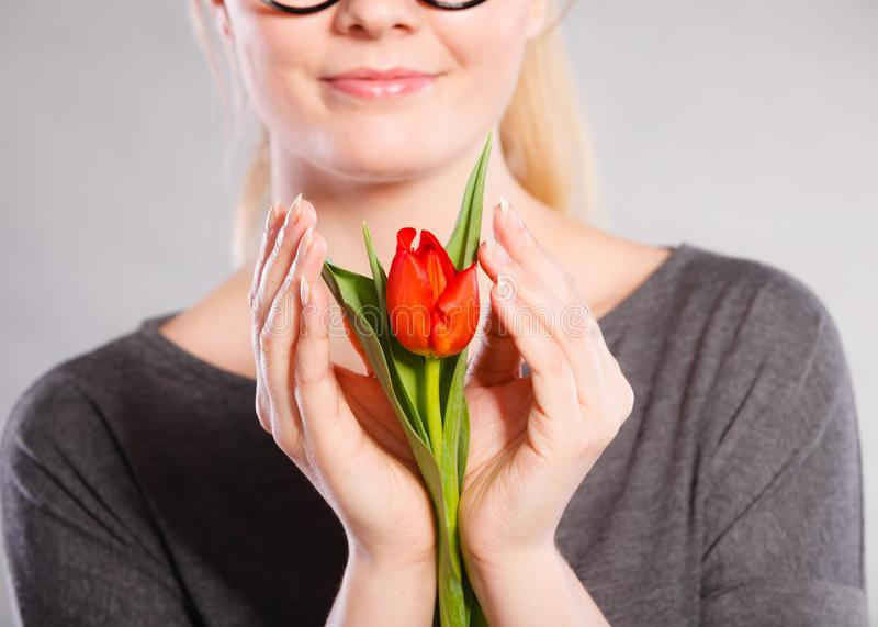 Smiling woman embracing flower stock photos