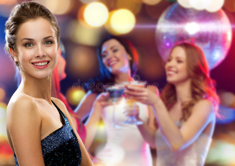 Smiling woman in evening dress stock images
