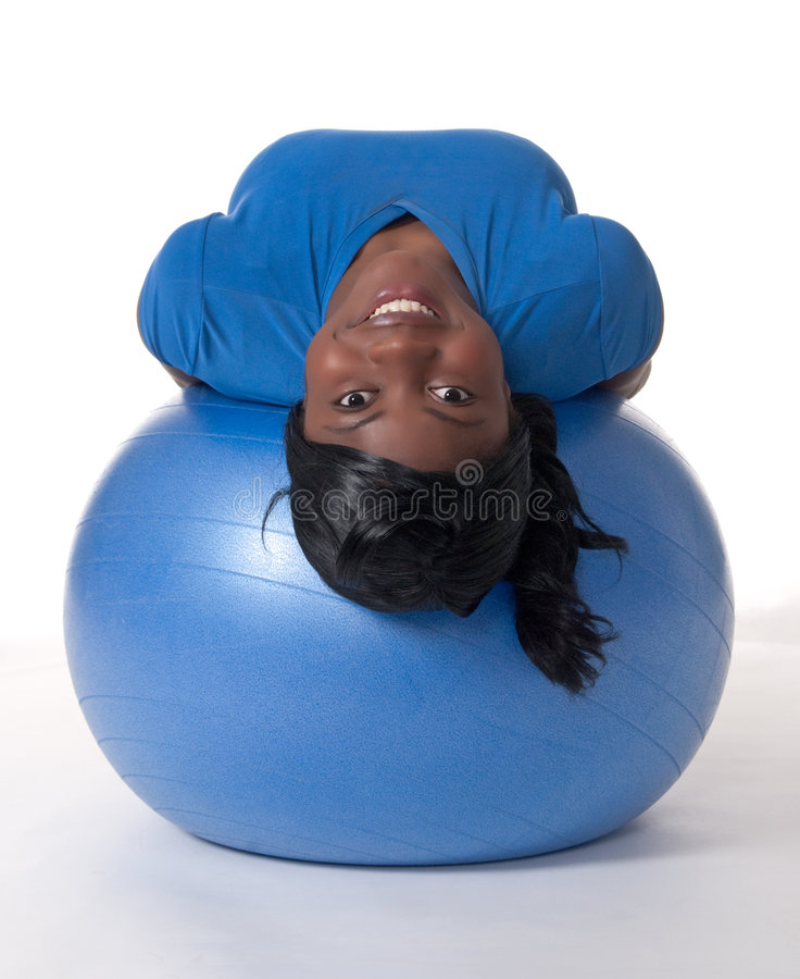 Smiling woman on exercise ball royalty free stock image
