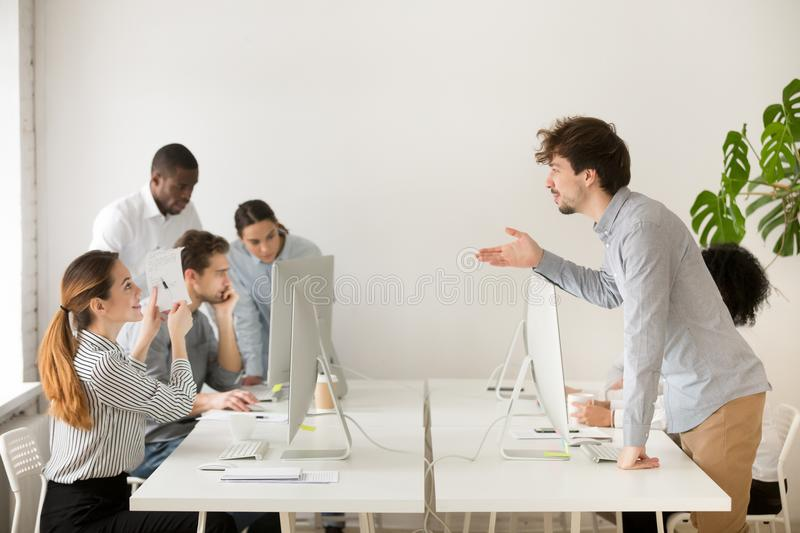 Smiling woman explaining corporate paperwork to new hire in offi stock images