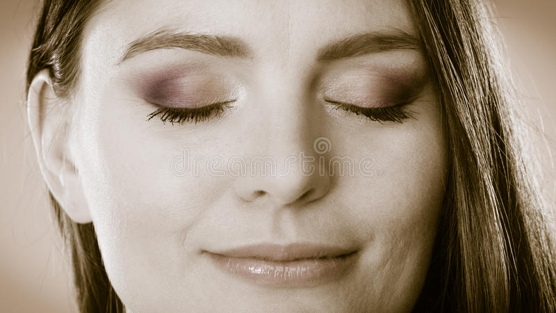 Smiling woman face with closed eyes, girl daydreaming stock photos