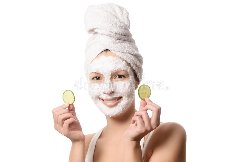 Smiling woman in a face mask stock photos