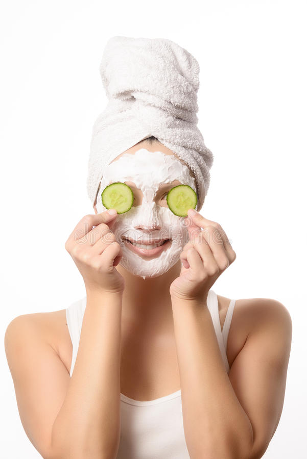 Smiling woman in a face mask royalty free stock image