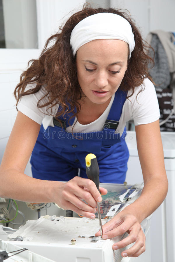 Download Smiling Woman Fixing Washing Machine Stock Image - Image: 16339449