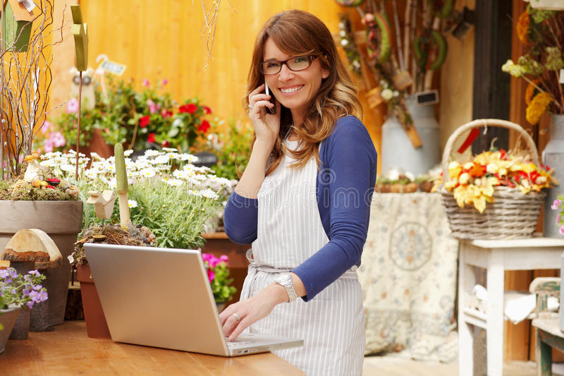 Smiling Woman Florist, Small Business Flower Shop Owner stock photography
