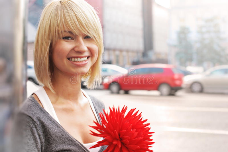 Smiling woman with flower royalty free stock photography