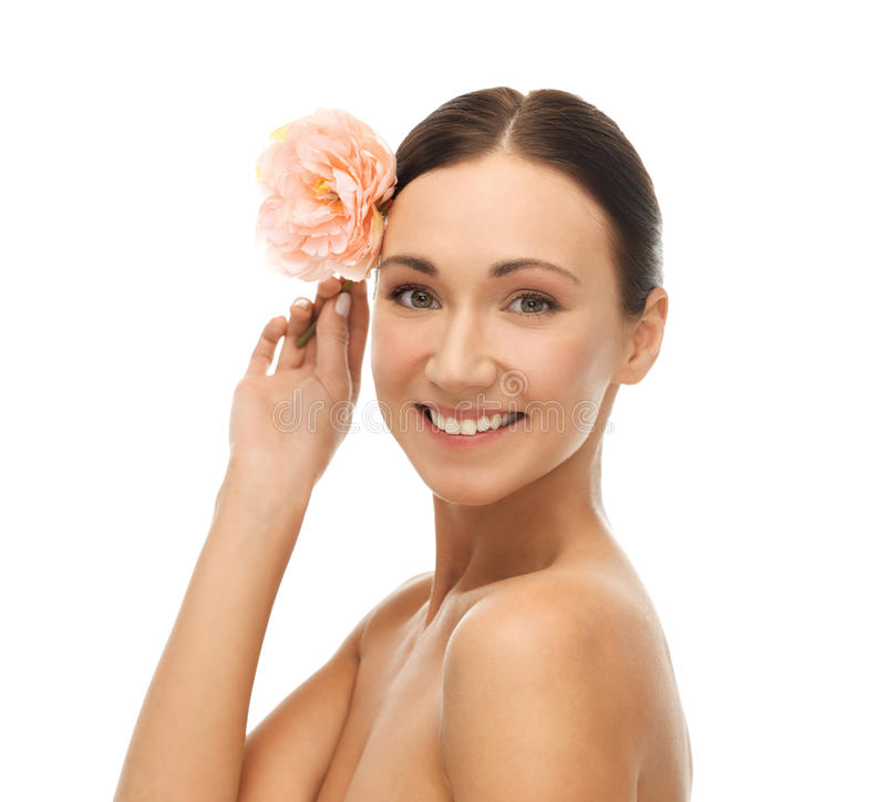 Smiling woman with flowers royalty free stock photo