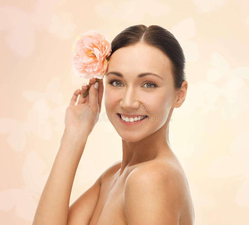 Smiling woman with flowers stock photo