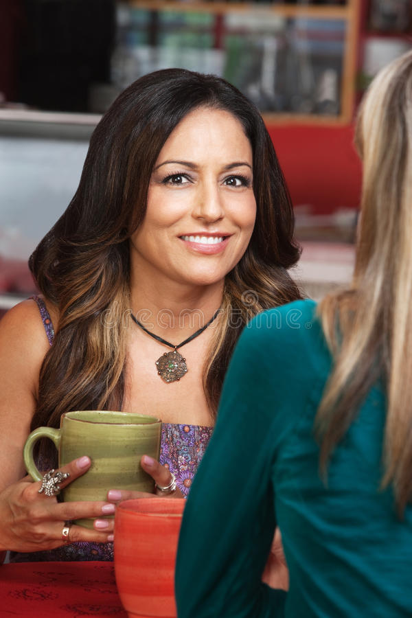Download Smiling Woman With Friend In Cafe Stock Image - Image of latino, conversation: 28339995