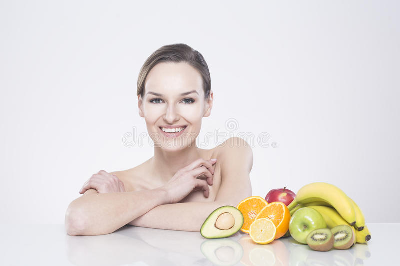Smiling woman with fruits royalty free stock image