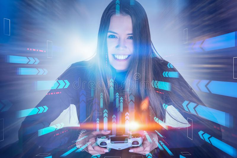 Smiling woman with gamepad, arrows. Smiling young woman with long hair sitting in armchair with gamepad. Double exposure of arrows. Concept of gaming. Toned royalty free stock photography