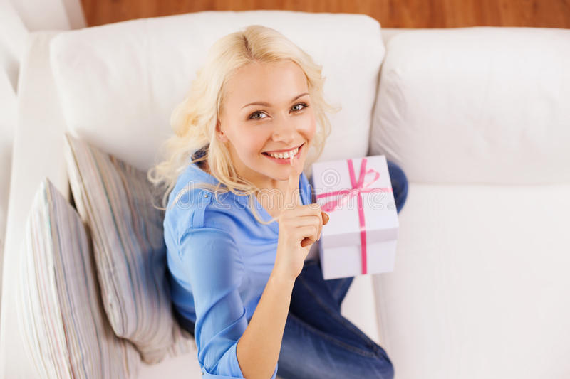 Download Smiling Woman With Gift Box At Home Stock Photo - Image: 40042204