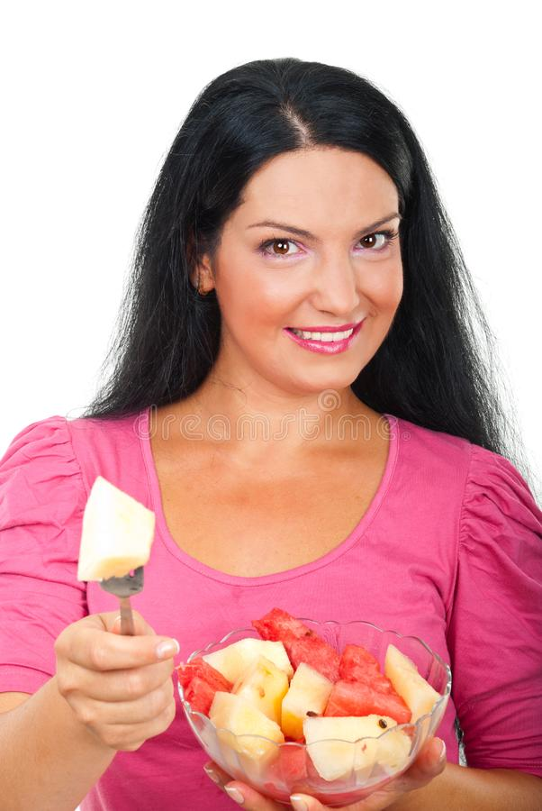 Smiling woman giving a piece of melon royalty free stock image
