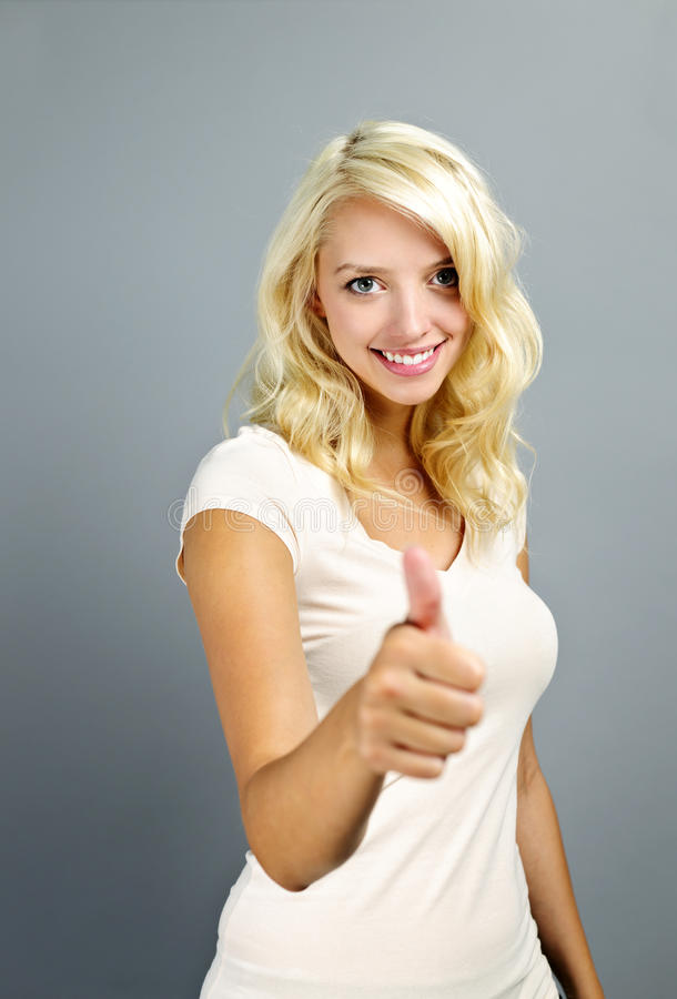Download Smiling Woman Giving Thumbs Up Stock Photo - Image: 21902586