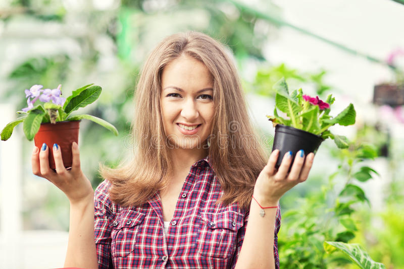 Smiling woman in greenhouse royalty free stock photos