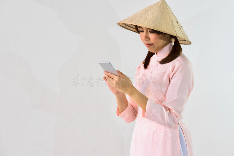 Smiling woman hand typing text message on smart phone royalty free stock photo