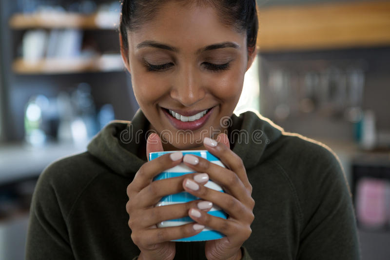 Smiling woman having coffee stock photography