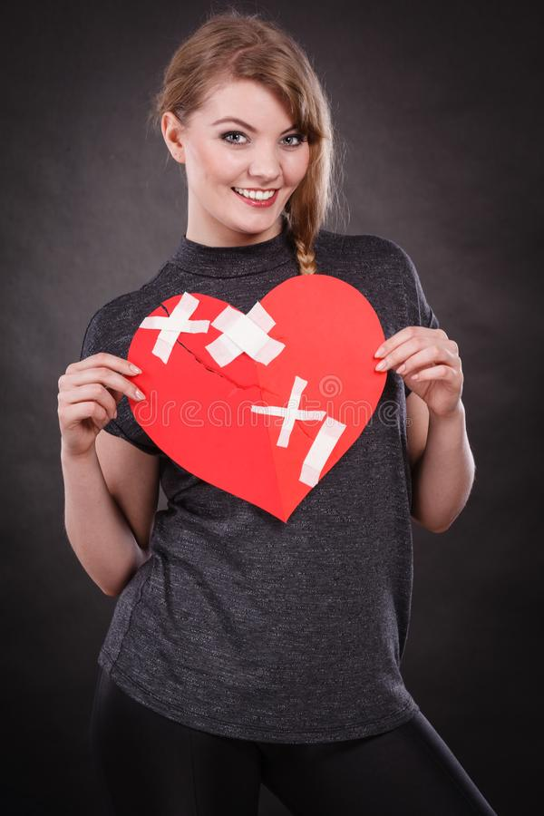 Smiling woman with healed heart royalty free stock photos
