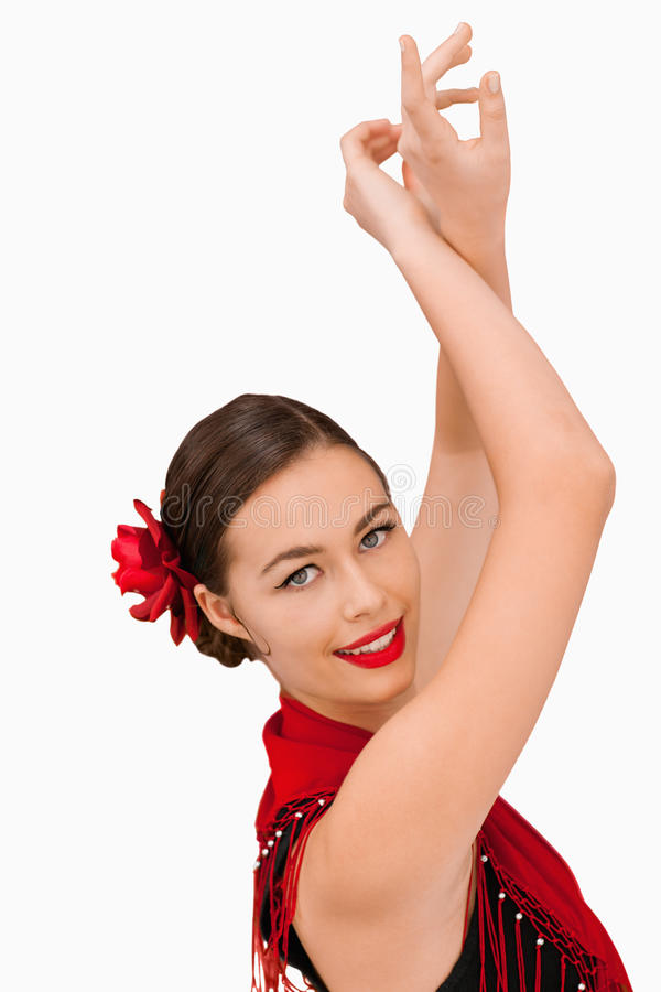 Smiling Woman With Her Arms Raised Stock Photo