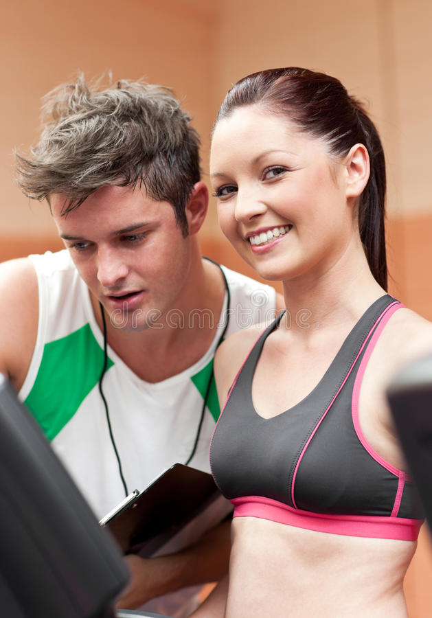 Download Smiling Woman With Her Coach Watching Her Results Stock Photo - Image of effort, healthy: 16093484