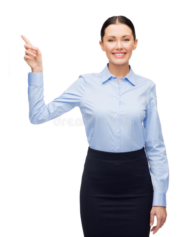 Smiling woman with her finger up stock photography