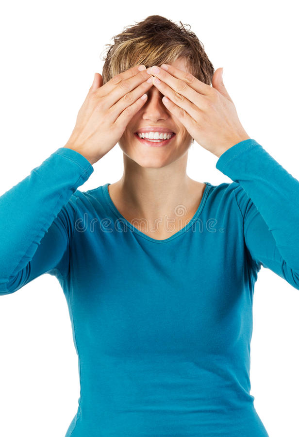 Smiling woman hides her eyes stock photo